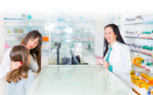 Mother and Daughter interacting with Pharmacist